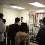 Claudio, a graduate student in SMSL, demonstrates the shape memory alloy experiments to Pearland High School students.